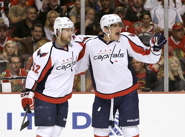 Washington Capitals right wing Alex Ovechkin, right, celebrates his goal with Mike Green during the first period of an NHL hockey game against the Chicago Blackhawks, Tuesday, Oct. 1, 2013, in Chicago. (AP Photo/Nam Y. Huh)