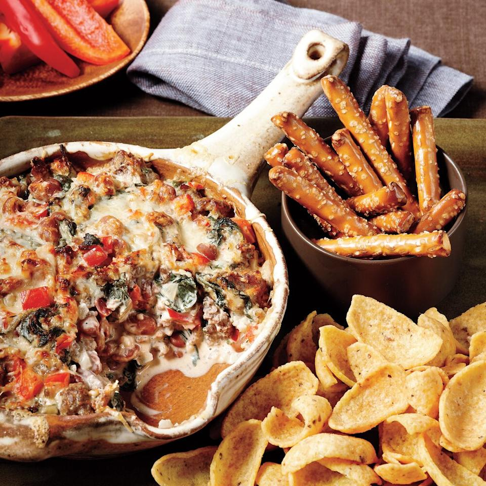 """<p>Make the ultimate spinach dip by adding ground sausage, pinto beans, cream cheese,and Parmesan. It's almost hearty enough to be a main dish.</p> <p><a href=""""https://www.myrecipes.com/recipe/sausage-bean-spinach-dip"""">Sausage, Bean, and Spinach Dip Recipe</a></p>"""