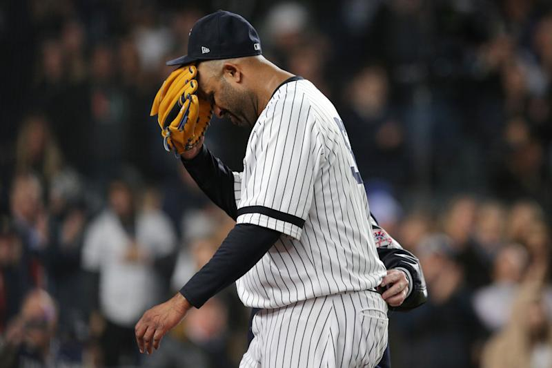 Oct 17, 2019; Bronx, NY, USA; New York Yankees pitcher CC Sabathia (52) reacts as he is walked off the field by trainer Steve Donohue after suffering an apparent injury against the Houston Astros during the eighth inning of game four of the 2019 ALCS playoff baseball series at Yankee Stadium. Mandatory Credit: Brad Penner-USA TODAY Sports