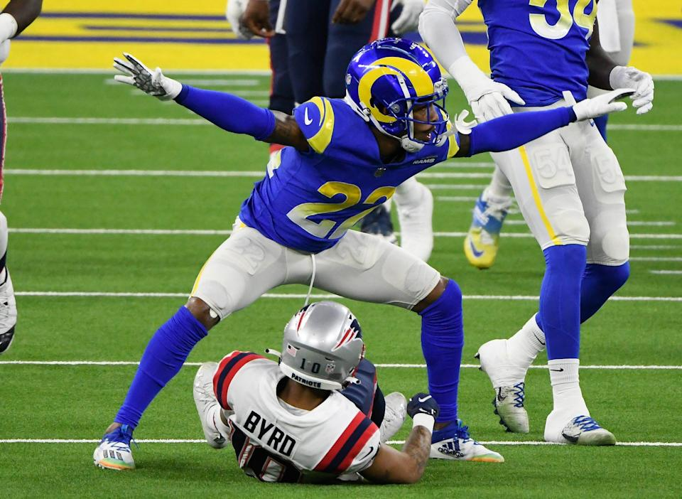 Los Angeles Rams cornerback Troy Hill (22) signals incomplete pass after breaking up a play to New England Patriots wide receiver Damiere Byrd.