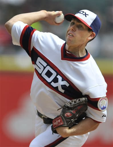 Chicago White Sox starting pitcher Dylan Axelrod delivers against the Tampa Bay Rays during the first inning of a baseball game in Chicago, Sunday, April 28, 2013. (AP Photo/Paul Beaty)