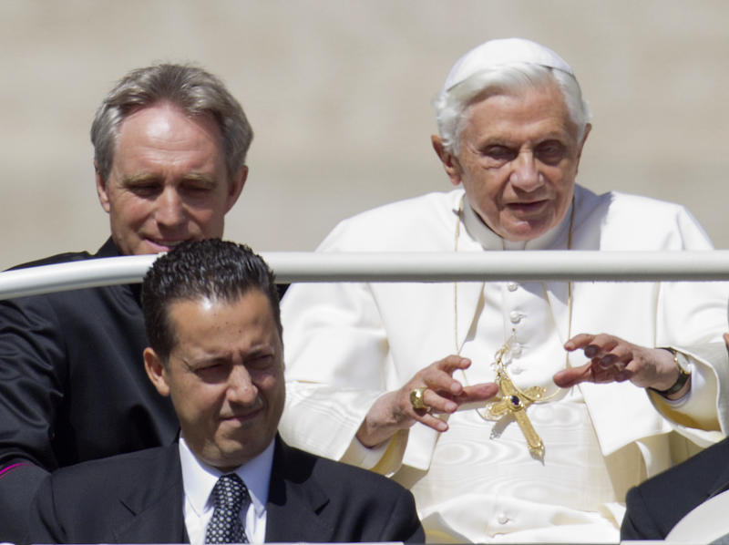 FILE -- In this photo taken Wednesday, May, 23, 2012, Pope Benedict XVI, flanked by his private secretary Georg Gaenswein, top left, and his butler Paolo Gabiele arrives at St. Peter's square at the Vatican for a general audience. A verdict in the case of the pope's butler accused of leaking papal documents may help close one of the most damaging scandals of Pope Benedict XVI's papacy. But even after Paolo Gabriele's fate is decided by a Vatican tribunal Saturday, Oct. 6, 2012 a core question will remain open: Did he really act alone in exposing the secrets of one of the most secretive institutions in the world?  (AP Photo/Andrew Medichini, File)