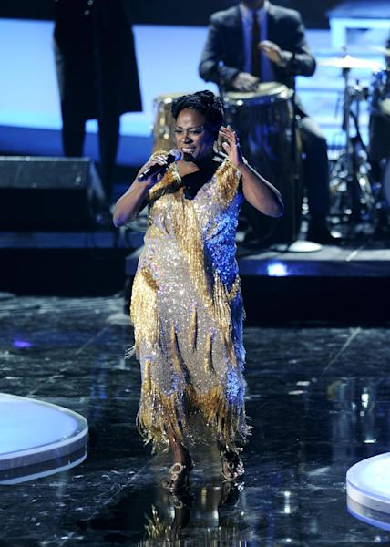 """FILE - In this Dec. 18, 2011 file photo, Sharon Jones & the Dap-Kings perform onstage at the """"Vh1 Divas Celebrates Soul,"""" in New York. Jones, a big-voiced soul singer who performed with high energy onstage has died at age 60 in New York, after battling pancreatic cancer. Her representative Judy Miller Silverman says she died Friday, Nov. 18, 2016, at a Cooperstown hospital surrounded by her band, the Dap-Kings. (AP Photo/Evan Agostini, File)"""