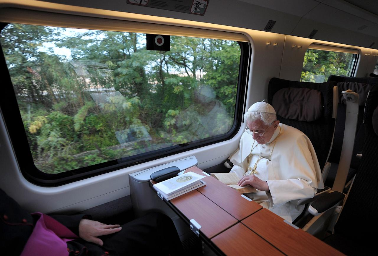 ASSISI, PERUGIA  - OCTOBER 27:  Pope Benedict XVI travels to Assisi by train on October 27, 2011 in Assisi, Italy. The Pontiff made a pilgrimage to the home of Saint Francis in Assisi to attend the meeting 'Pilgrims of truth, pilgrims of peace'; a day of reflection, dialogue and prayer for peace and justice in the world. (Photo by L'Osservatore Romano/Vatican Pool via Getty Images)
