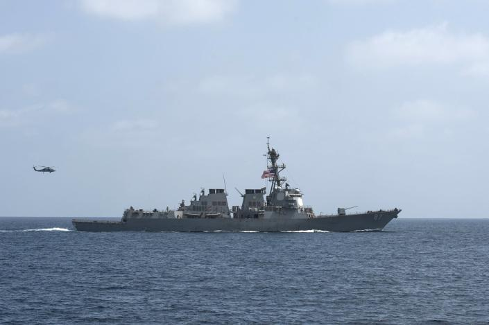 The U.S. Navy guided-missile destroyer USS Mason conducts divisional tactic maneuvers as part of a Commander, Task Force 55, exercise in the Gulf of Oman September 10, 2016. U.S. Navy/Mass Communication Specialist 1st Class Blake Midnight/Handout via REUTERS THIS IMAGE HAS BEEN SUPPLIED BY A THIRD PARTY. IT IS DISTRIBUTED, EXACTLY AS RECEIVED BY REUTERS, AS A SERVICE TO CLIENTS. FOR EDITORIAL USE ONLY. NOT FOR SALE FOR MARKETING OR ADVERTISING CAMPAIGNS