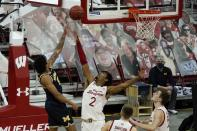 Michigan's Eli Brooks shoots over Wisconsin's Aleem Ford during the second half of an NCAA college basketball game Sunday, Feb. 14, 2021, in Madison, Wis. (AP Photo/Morry Gash)