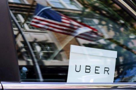FILE PHOTO: An Uber sign is seen in a car in New York, U.S. June 30, 2015. REUTERS/Eduardo Munoz/File Photo