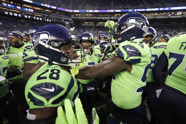 With quarterback Russell Wilson at the center, Seattle Seahawks huddle before an NFL football game against the Minnesota Vikings, Monday, Dec. 2, 2019, in Seattle. (AP Photo/Ted S. Warren)
