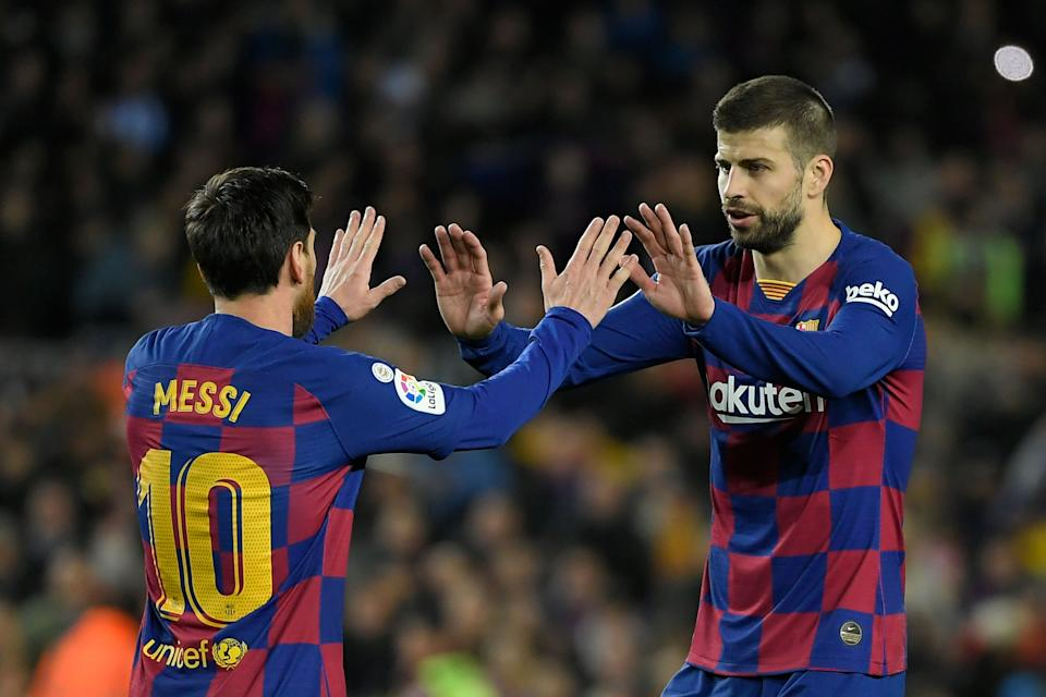 Barcelona's Argentine forward Lionel Messi (pictured left) celebrates with Barcelona's Spanish defender Gerard Pique (pictured right).