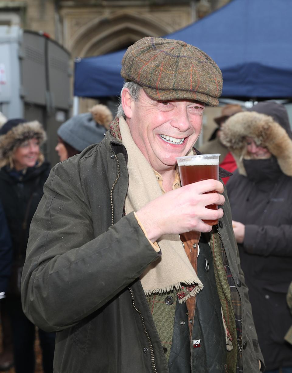 Nigel Farage enjoys a pint before the Old Surrey Burstow and West Kent Boxing Day Hunt in Edenbridge, Kent.
