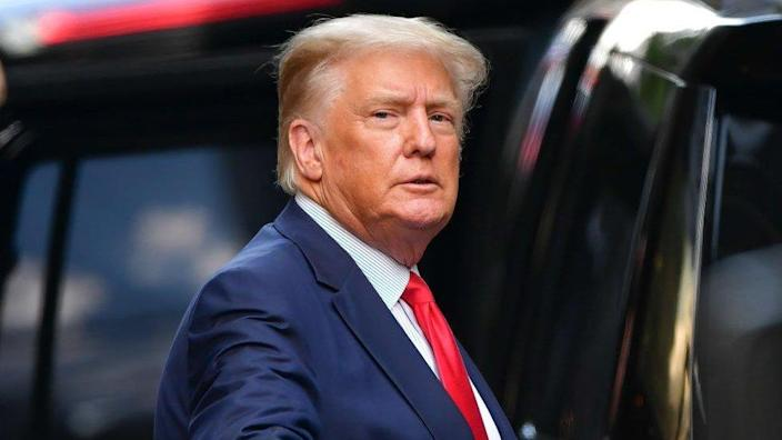 Trump getting in a car in New York city