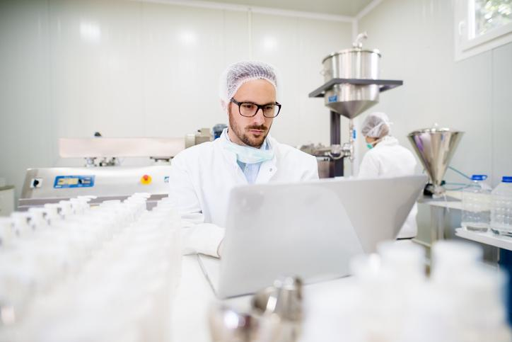 A technician in a drug manufacturing facility.