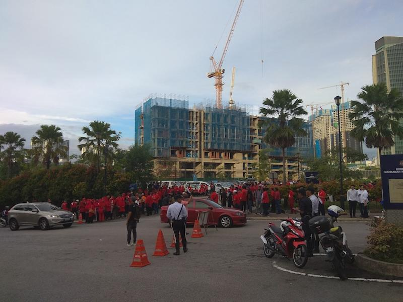 Supporters dressed in red, a colour associated with Umno, gathered as early as 6.30am outside the Kuala Lumpur Court Complex ahead of expected corruption charges against Datuk Seri Ahmad Zahid Hamidi, October 19, 2018. — Picture by Kenneth Tee