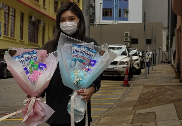 Flower shop owner Iris Leung delivered face masks along with flowers on Valentine's Day in Hong Kong (Vincent Yu/AP)