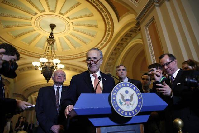 Senate Minority Leader Charles Schumer, flanked by Sen. Bernie Sanders, left, and Sen. Jeff Merkley, D-Ore., meets with reporters on Capitol Hill, May 23, 2017. (Photo: Jacquelyn Martin/AP)
