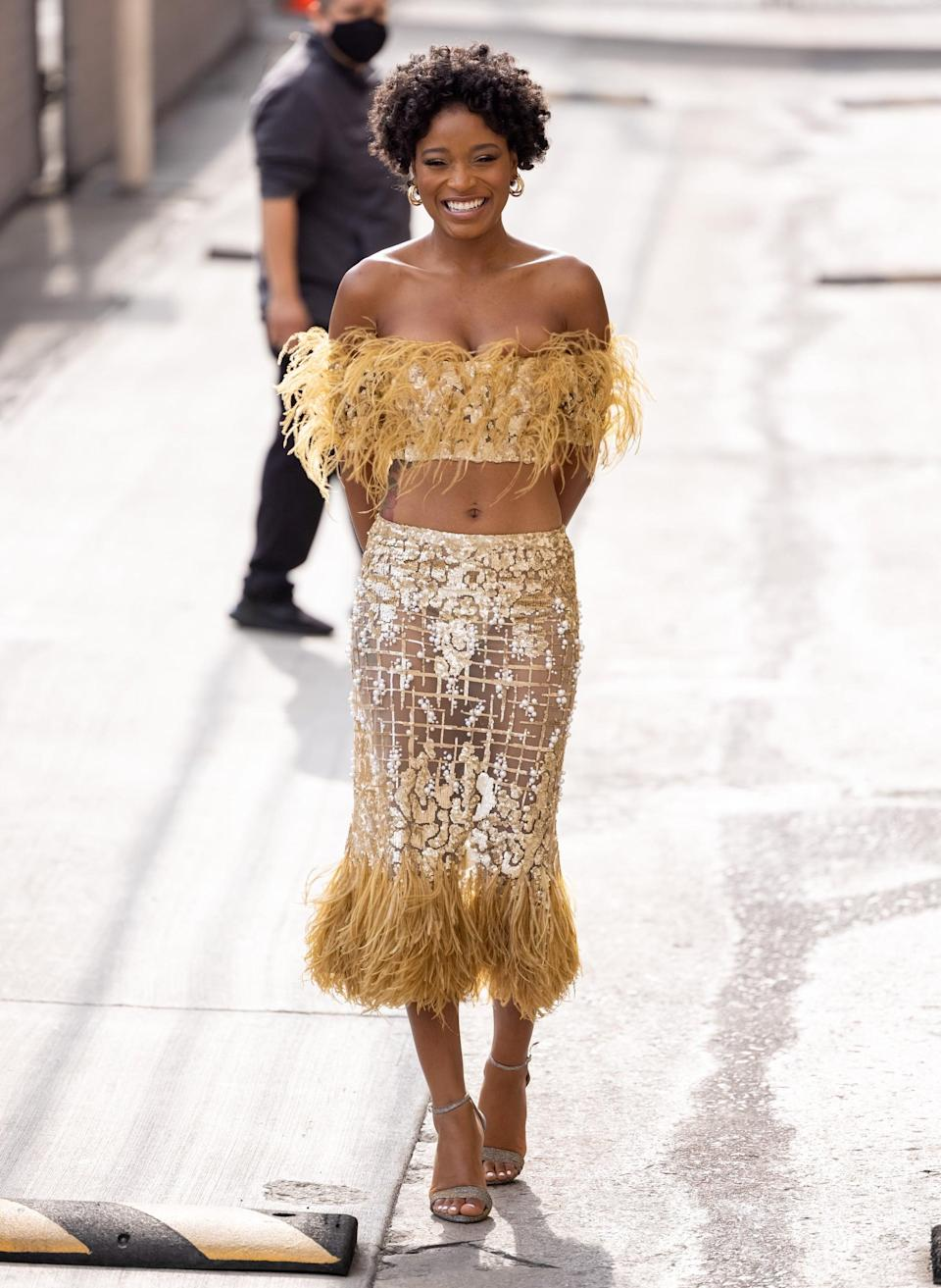 """<p>The actress took our breath away in <a href=""""https://www.popsugar.com/fashion/keke-palmer-jimmy-kimmel-feather-skirt-set-48468773"""" class=""""link rapid-noclick-resp"""" rel=""""nofollow noopener"""" target=""""_blank"""" data-ylk=""""slk:this feathered, sparkly Georges Chakra Couture look"""">this feathered, sparkly Georges Chakra Couture look</a>. </p>"""