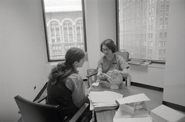 In a New York City abortion clinic in 1971, a patient is shown a model of the female reproductive system by a clinic member. (Photo: Bettmann Archive/Getty Images)