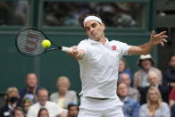 Switzerland's Roger Federer returns the ball to Italy's Lorenzo Sonego on day seven of the Wimbledon Tennis Championships in London, Monday, July 5, 2021. (AP Photo/Kirsty Wigglesworth)