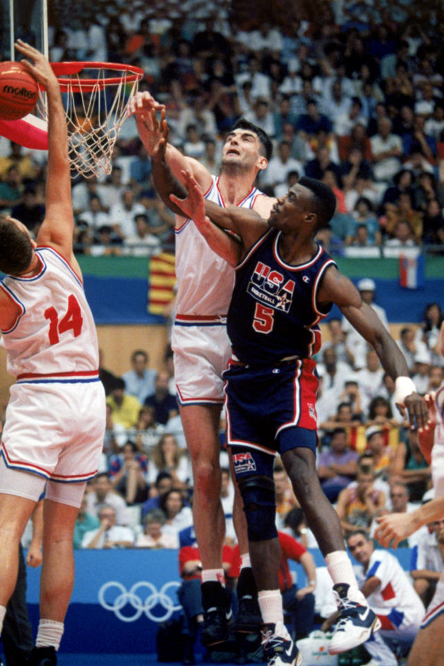 """BARCELONA, SPAIN - JULY 27:  David Robinson #5 of the United States goes up for a rebound against Stojan Vrankovic #11 and Dino Radja #14 of Croatia during the 1992 Olympic game against Croatia on July 27, 1992 in Barcelona, Spain. The """"Dream Team"""" defeated Croatia 103-70. NOTE TO USER: User expressly acknowledges and agress that, by downloading and or using this photograph, User is consenting to the terms and conditions of the Getty Images License Agreement. (Photo by Mike Powell/Getty Images)"""