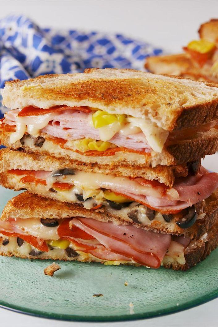 """<p>Stuffed with Italian meats and pickled vegetables, this is a heartier version of your typical grilled cheese with a little more spice. </p><p><strong><em>Get the recipe at <a href=""""https://www.delish.com/cooking/recipe-ideas/a19425438/antipasto-grilled-cheese-recipe/"""" rel=""""nofollow noopener"""" target=""""_blank"""" data-ylk=""""slk:Delish."""" class=""""link rapid-noclick-resp"""">Delish.</a></em></strong></p>"""