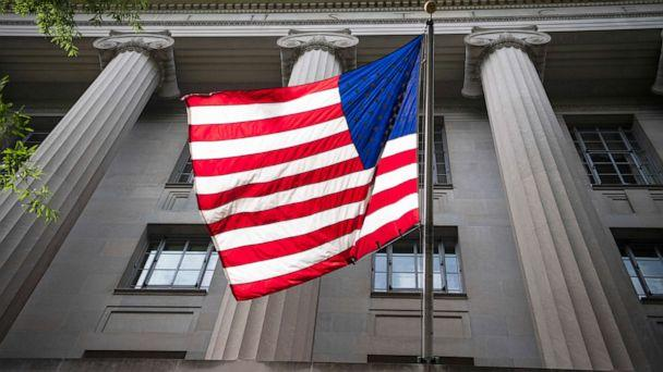 PHOTO: An American flag is displayed on the Pennsylvania Avenue side of the Department of Justice, June 3, 2020. (Tom Williams/CQ-Roll Call, Inc via Getty Images)