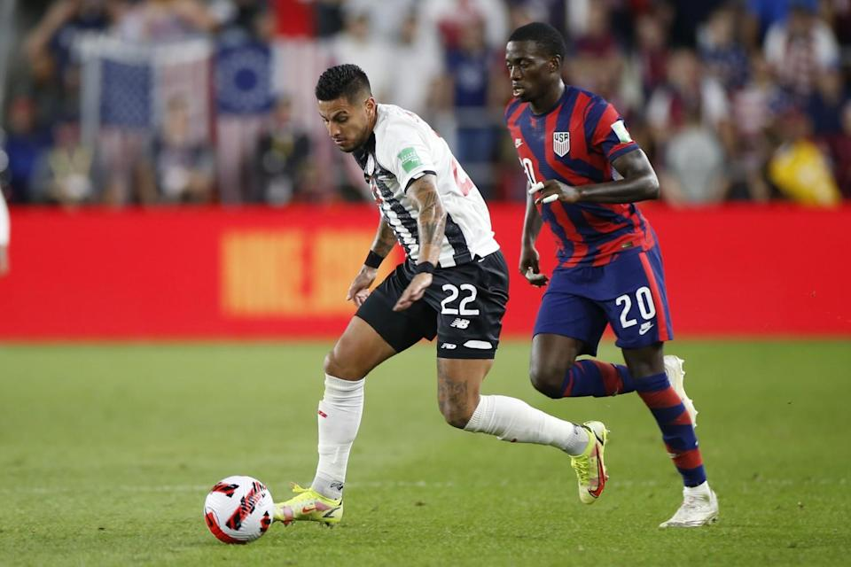Costa Rica's Ronald Matarrita controls the ball as United States' Tim Weah defends.