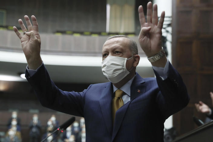 """Turkey's President Recep Tayyip Erdogan gestures as he arrives to speak to his ruling party's lawmakers, in Ankara, Turkey, Wednesday, Dec. 23. 2020. Turkey's president has lashed out against the European Court of Human Rights after its ruling that Turkey must immediately release a prominent Kurdish politician. Speaking to his ruling party lawmakers Wednesday, Turkish President Recep Tayyip Erdogan called imprisoned politician Selahattin Demirtas a """"terrorist"""" and accused the European court of """"defending a terrorist."""" (Turkish Presidency via AP, Pool)"""