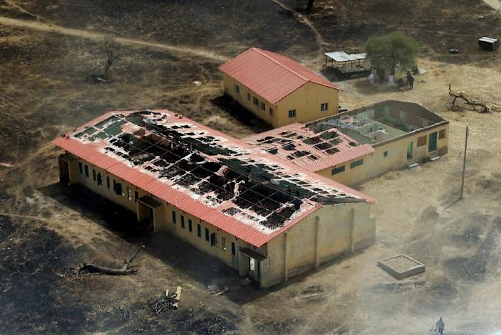 The burnt-out classrooms of the Government Secondary School in Chibok, Nigeria, are pictured in 2015, a year after Boko Haram Islamist fighters seized 276 schoolgirls on April 14, 2014 (AFP Photo/Sunday Aghaeze)