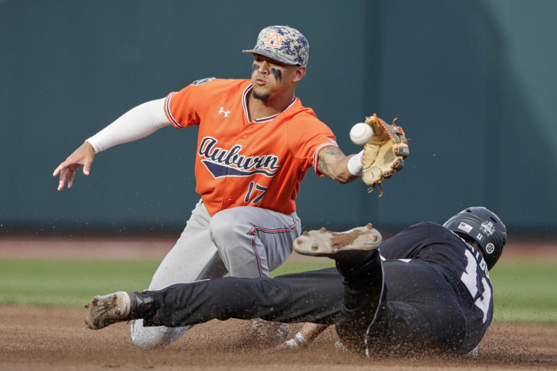 Mississippi State's Jordan Westburg (11) steals second base against Auburn shortstop Will Holland (17) in the first inning of an NCAA College World Series baseball game in Omaha, Neb., Sunday, June 16, 2019. (AP Photo/Nati Harnik)