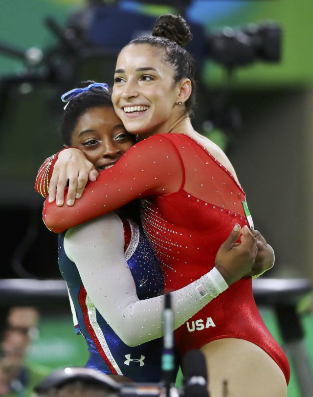 2016 Rio Olympics - Artistic Gymnastics - Final - Women's Individual All-Around Final - Rio Olympic Arena - Rio de Janeiro, Brazil - 11/08/2016. Simone Biles (USA) of USA (L) and Alexandra Raisman (USA) of USA (Aly Raisman) celebrate winning gold and silver respectively at the women's individual all-around final. REUTERS/Mike Blake FOR EDITORIAL USE ONLY. NOT FOR SALE FOR MARKETING OR ADVERTISING CAMPAIGNS.