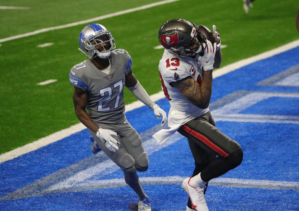 Tampa Bay Buccaneers receiver Mike Evans catches a touchdown pass against Detroit Lions cornerback Justin Coleman during the first half Saturday, Dec. 26, 2020 at Ford Field.