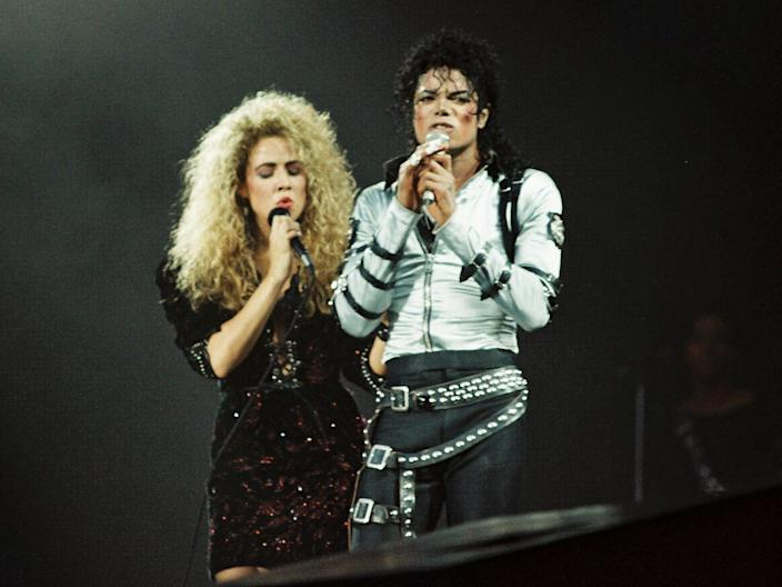 Sheryl Crow joins Michael Jackson to perform on stage on his BAD tour at Wembley Stadium.