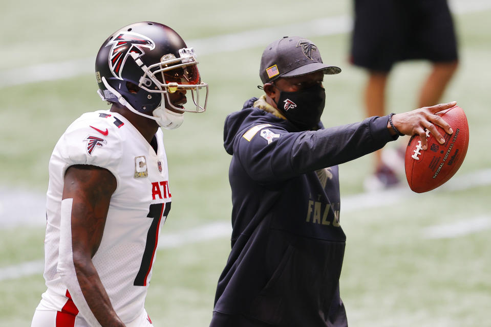 The Falcons' Raheem Morris, pictured with Julio Jones before a home game in November, is 4-5 as interim head coach. (Photo by Kevin C. Cox/Getty Images)
