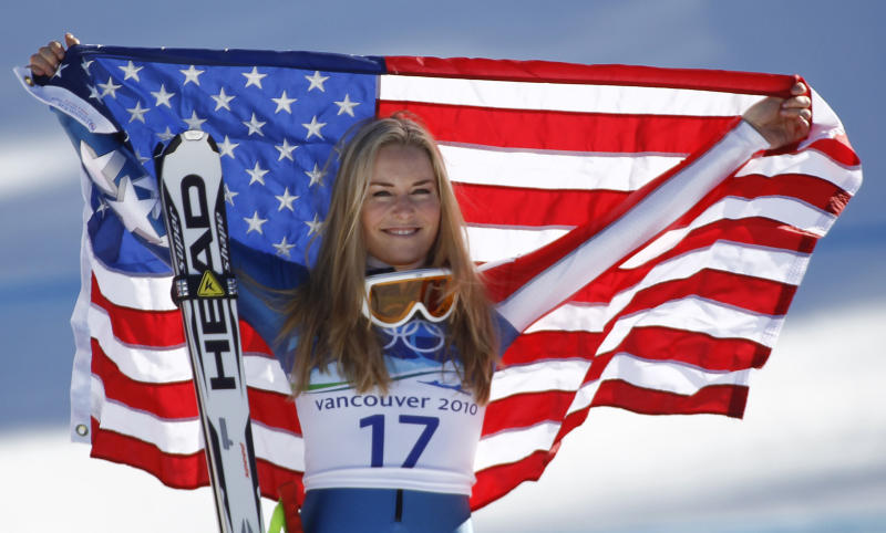 Vonn holds up a flag after winning bronze at the 2010 Winter Olympics.  (Leonhard Foeger / Reuters)