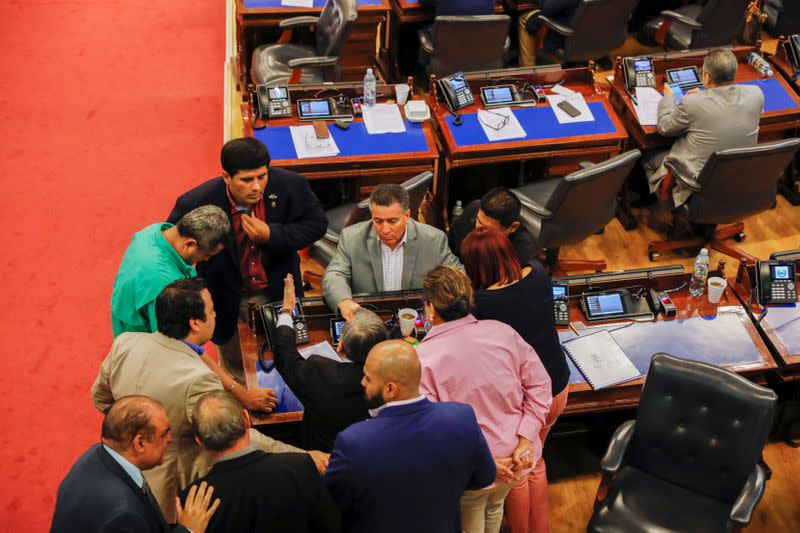 Representatives discuss during congress session on the approval of an amnesty bill that exempts the prosecution of crimes committed during the civil war, in San Salvador, El Salvador