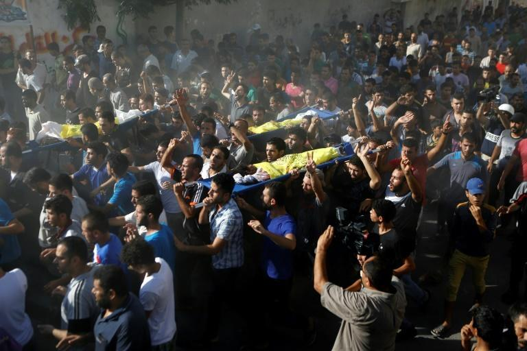 A crowd of Palestinian mourners took part in the funeral of the four boys killed by an Israeli airstrike in 2014 while playing football on a beach