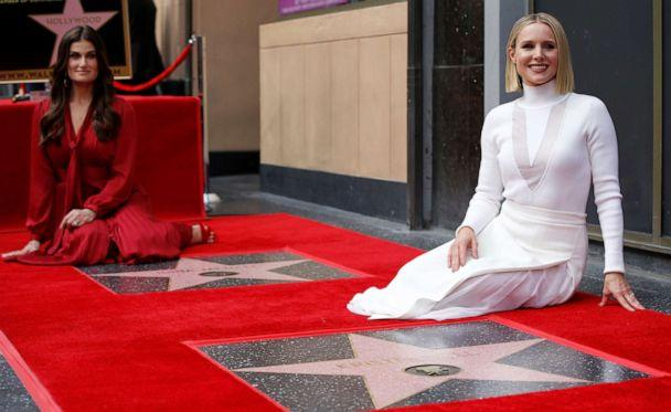 PHOTO: Kristen Bell, right, and Idina Menzel pose by their stars after they were unveiled on the Hollywood Walk of Fame in Los Angeles, Nov. 19, 2019. (Mario Anzuoni/Reuters)