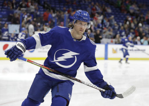 FILE - In this March 5, 2020, file photo, Tampa Bay Lightning center Blake Coleman (20) skates before an NHL hockey game against the Montreal Canadiens in Tampa, Fla. The Lightning acquired Coleman and Barclay Goodrow shortly before the February trade deadline. (AP Photo/Chris O'Meara, File)
