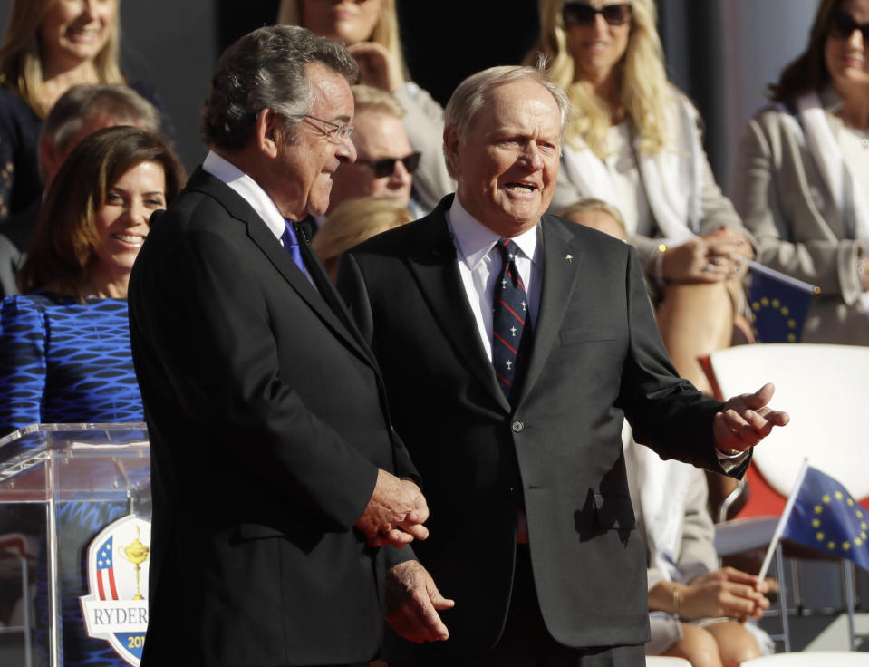 FILE - Tony Jacklin, left, and Jack Nicklaus talk during the opening ceremony for the Ryder Cup golf tournament at Hazeltine National Golf Club in Chaska, Minn., in this Thursday, Sept. 29, 2016, file photo. The Ryder Cup has named an award after them for a player on each team that embodies the spirit of the matches. (AP Photo/David J. Phillip, File)