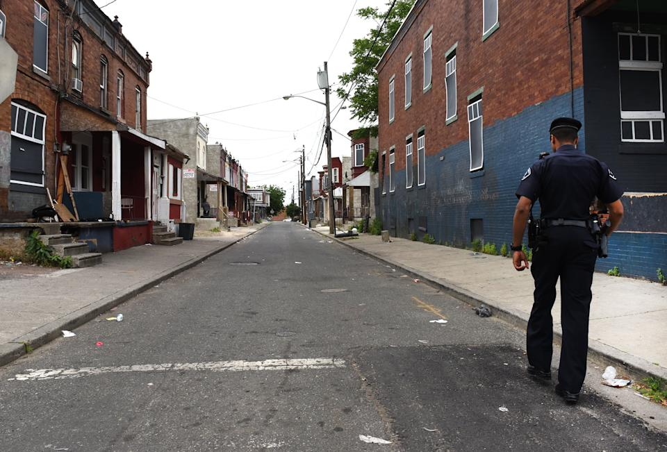 Camden County Police Department officer Jose Delvalle is seen on foot patrol in Camden, New Jersey, on May 24, 2017. In 2013  the city of Camden, New Jersey, dissolved its police force, replacing it with a new county-run department where they are turning around a city that had one of the highest crime rates in the country. Police reform and falling crime statistics turned Camden into a poster child for better policing.  / AFP PHOTO / TIMOTHY A. CLARY / TO GO WITH AFP STORY by Jennie MATTHEW,  US-politics-police          (Photo credit should read TIMOTHY A. CLARY/AFP via Getty Images)