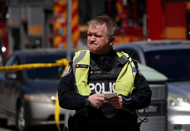 <p>A police officer responds to an incident where a van struck multiple people at a major intersection in Toronto's northern suburbs in Toronto, Ontario, Canada, April 23, 2018. (Photo: Carlo Allegri/Reuters) </p>