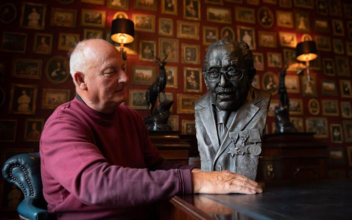 Garry McBride of Monumental Icons with a bronze bust of Captain Sir Tom Moore - PA