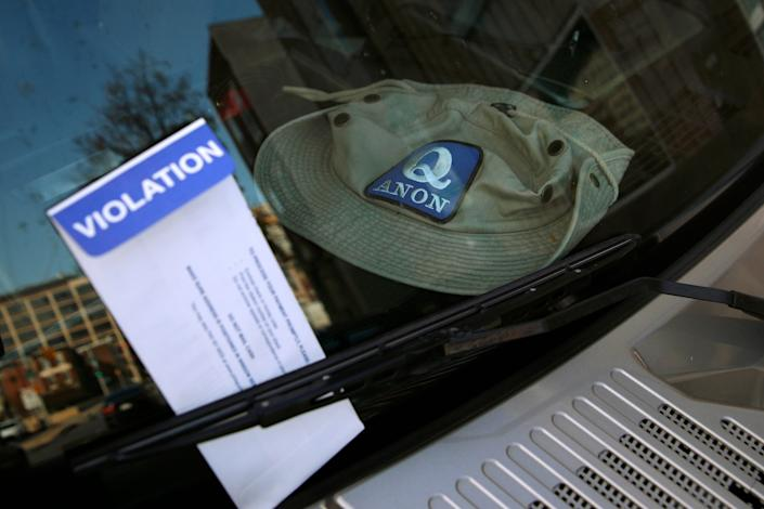 A parking violation envelope is affixed to the windshield of a Hummer vehicle parked near the Pennsylvania Convention Center where votes are being counted, Friday, Nov. 6, 2020, in Philadelphia.