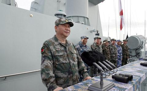 <span>Chinese President Xi Jinping delivers a speech as he reviews a military display of Chinese People's Liberation Army Navy in the South China Sea</span> <span>Credit: Li Gang/Xinhua via REUTERS </span>