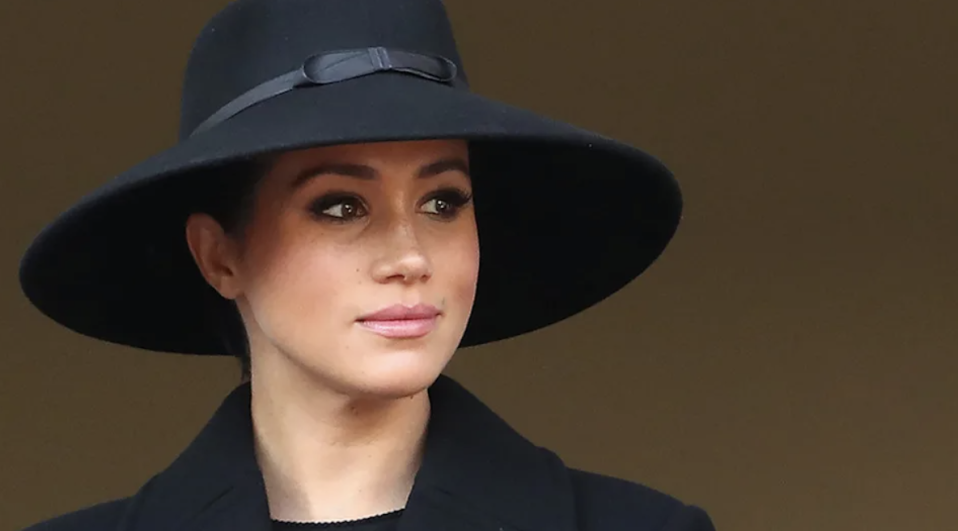 Meghan Markle in a black hat