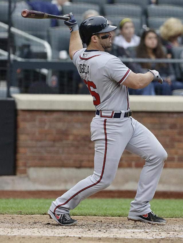 Atlanta Braves' Dan Uggla follows through with a two-run home run during the fourth inning of a baseball game against the New York Mets Thursday, July 25, 2013, in New York. (AP Photo/Frank Franklin II)