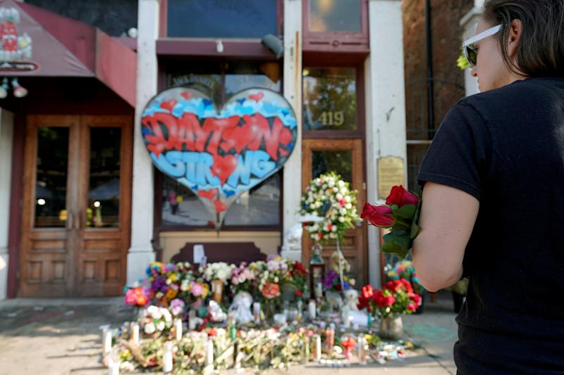A Oregon District resident stands at a memorial for those killed during Sunday morning's a mass shooting in Dayton, Ohio, U.S. August 7, 2019. REUTERS/Bryan Woolston TPX IMAGES OF THE DAY
