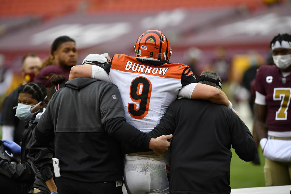Whoever takes Trevor Lawrence or Justin Fields, this draft's prized quarterbacks, would be wise to learn from the mistakes the Bengals made with Joe Burrow. (Photo by Randy Litzinger/Icon Sportswire via Getty Images)