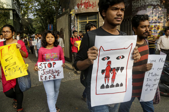 University students hold placards demanding justice in the case of a veterinarian who was gang-raped and killed last week during a protest rally in Kolkata, India, Monday, Dec. 2, 2019. The burned body of the 27-year-old woman was found Thursday morning by a passer-by in an underpass in the southern city of Hyderabad after she went missing the previous night. (AP Photo/Bikas Das)