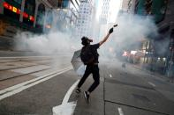 FILE PHOTO: Hong Kong police fire tear gas in feverish start to 22nd weekend of protests in Hong Kong